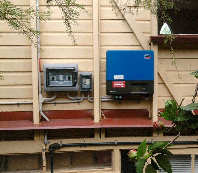 grid_feed_inverter_external_mount_on_timber_wall
